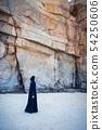 Muslim woman walking on the beach 54250606