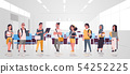 mix race teenage students group with backpacks holding books standing together education concept 54252225
