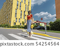 Attractive young woman in sunglasses crossing the road 54254564