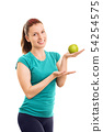 Female athlete holding a green apple 54254575
