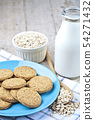 Fresh baked oat cookies on blue ceramic plate on 54271432