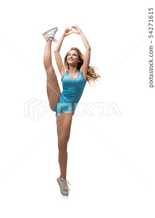 Athletic woman in swimsuit standing leg up 54271615