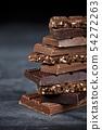 Chocolate bar pieces closeup. Sweet food photo 54272263