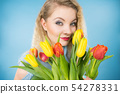 Pretty woman with red yellow tulips bunch 54278331