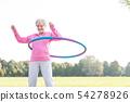 Senior woman doing gymnastic with hula hoop 54278926