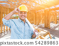 Hispanic Male Contractor with Blueprint Plans 54289863