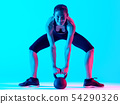 woman exercsing Kettle Bell fitness exercices 54290326