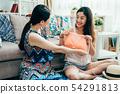 ladies holding bikini try during packing suitcase 54291813