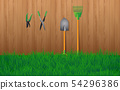 Gardening tools at wooden wall in the garden 54296386