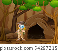Boy explorer standing near the cave 54297215