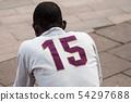 african man wearing a soccer tee shirt 54297688