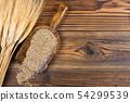 An old flour shovel with corn and corn ears lies 54299539
