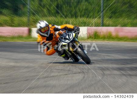 Motorcycle cornering on racing circuit 54302439