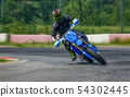 Extreme racer on corner of racing track 54302445