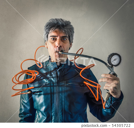 Stressed man with manometer in mouth 54305722