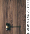 Wooden judge's gavel on wood background 54314184