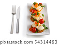 Portions of fish appetizers. 54314493