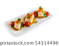 Portions of fish appetizers. 54314496
