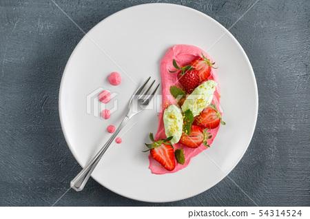 Strawberry dessert with mint. 54314524