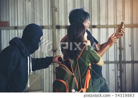 Robber thief criminal using gun extortion witness. 54319863