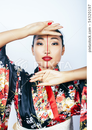 young pretty real geisha in kimono with sakura and decoration on white background isolated 54320197