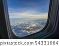 Aerial view sky and clouds through the plane illuminator after aircraft take off. 54331964