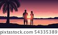 couple enjoy the sunset on a beautiful palm beach 54335389