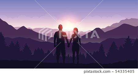 couple enjoy the mountain landscape view at sunrise 54335405