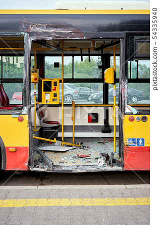 View of devastated city bus after road accident. 54335940