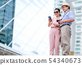 Couple of Asian old man and woman tourist phone in 54340673