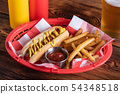 hot dog in basket with draft beer 54348518
