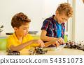 Happy positive boys constructing different toys together 54351073