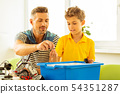 Joyful nice father and son constructing toys together 54351287