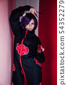 young woman in japanese anime cosplay, holding samurai sword. 54352279