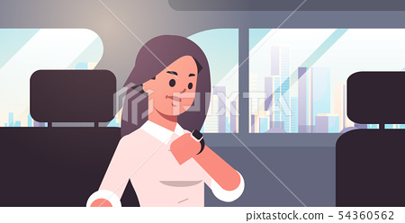 young businesswoman looking at clock checking time business woman car passenger sitting on back seat 54360562