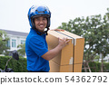 Delivery boy on scooter with parcel box driving 54362792