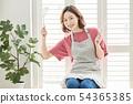 ผู้หญิงกำลังทำอาหาร 54365385