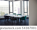 A large table with chairs in boardroom in office building. 54367001