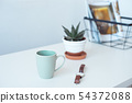 White desk table with copy space, supplies and coffee mug. Front view workspace and copy space. 54372088
