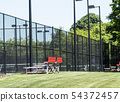 Small bleachers set up next to tennis courts 54372457