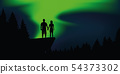 couple in love enjoy the polar lights on a cliff in the forest 54373302