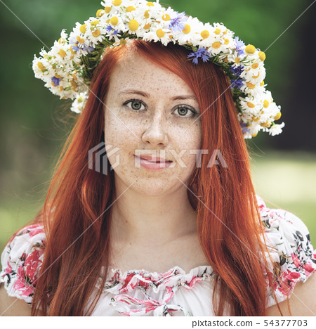 Portrait of a red-haired freckled woman 54377703