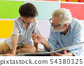 Grandfather and little cute grandson reading book 54380325