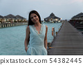 Beach vacation woman walking on bridge about 54382445