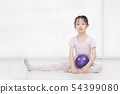 Asian girl in pink dress is holding ball.. 54399080