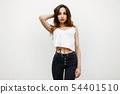 Beautiful young woman in a white tunic shirt  54401510