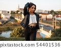 Beautiful woman in a black jacket, white T-shirt 54401536