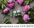 Pink peony flowers and gift box 54418656
