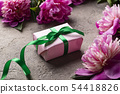 Pink peony flowers and gift box 54418826