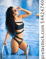 Luxury travel bikini girl vacation banner. Asian woman sun tan over idyllic ocean water in Bora Bora 54424740